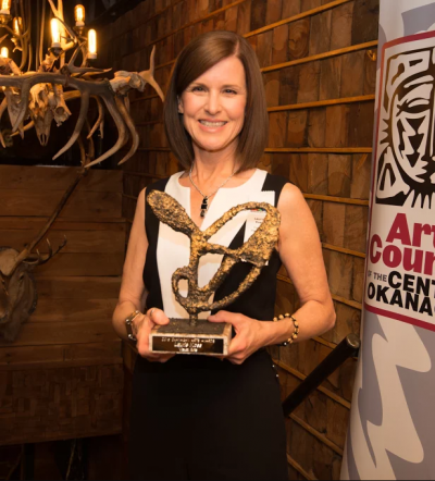 Photo with Laurie Koss holding ARTSCO Award